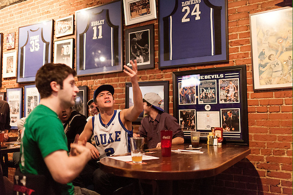 January 23, 2013. Durham, North Carolina. Jin Zhu (center) a Duke student and member of the Kappa Sigma fraternity watches in disgust as Duke lost a 63-90 blowout to Miami. He and his frat brothers had gathered at Charlie's Pub and Grille to watch the game.. Duke University has become a power house in the national college basketball arena under the coaching of head coach Mike Krzyzewski. But the university has fought hard to maintain its image of high academic achievement while riding the wave of collegiate athletic success.
