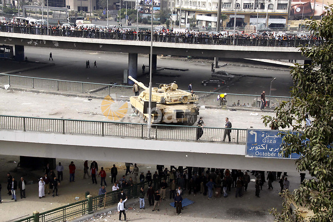 Anti-government protestors take part in a protest in Cairo's main square, Egypt, Thursday, Feb. 3, 2011. New clashes are heating up again and shots are being fired in the air around Cairo's central Tahrir Square as anti-government protesters push back regime supporters. The two sides are trading volleys of stone-throwing, but government backers are falling back and protesters are swarming onto a highway overpass from which their rivals had pelted them with stones and firebombs overnight. Photo by Ahmed Asad