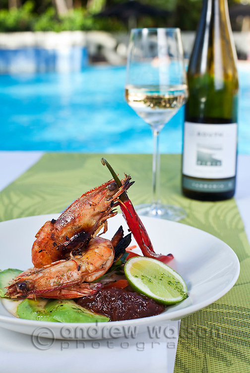 Barbeque prawns with spicy salsa by poolside at Shangri-La Hotel.  Cairns, Queensland, Australia