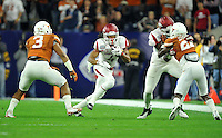 NWA Media/Michael Woods --12/29/2014-- w @NWAMICHAELW...University of Arkansas receiver Keon Hatcher finds a hole in the Texas defense as he runs for a gain in the 1st quarter of the Texas Bowl Monday night at  NRG Stadium in Houston.
