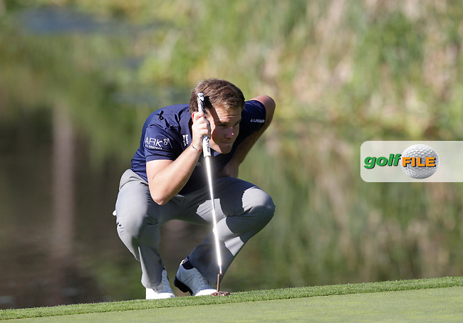 Tyrrell Hatton (ENG) lines up his putt on the 4th green during Thursday's Round 1 of the 2014 Open de Espana held at the PGA Catalunya Resort, Girona, Spain. Wednesday 15th May 2014.<br /> Picture: Eoin Clarke www.golffile.ie