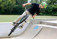 NWA Democrat-Gazette/DAVID GOTTSCHALK   Colton Keen, 15, watches his landing as he warms up at the Walker Park Skate Park in Fayetteville Monday, August 10, 2015. Keen was riding with Evan Procell, 16. Walker Park was the second park added to the city parks system in 1949.