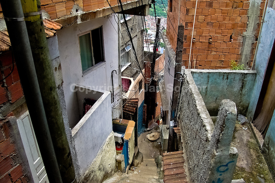 A narrow steep backstreet in Rocinha, the largest slum in Rio de Janeiro, 28 February 2004.