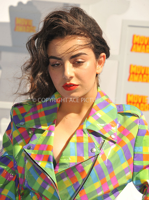 WWW.ACEPIXS.COM<br /> <br /> April 12 2015, LA<br /> <br /> Charli XCX arriving at the 2015 MTV Movie Awards at the Nokia Theatre L.A. Live on April 12, 2015 in Los Angeles, California.<br /> <br /> By Line: Peter West/ACE Pictures<br /> <br /> <br /> ACE Pictures, Inc.<br /> tel: 646 769 0430<br /> Email: info@acepixs.com<br /> www.acepixs.com