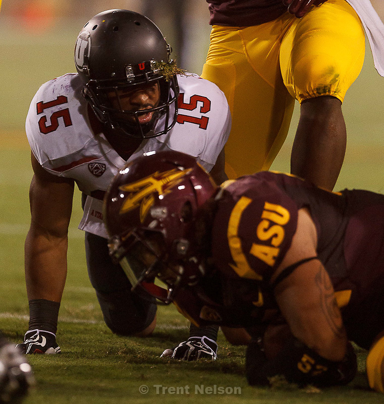 Trent Nelson  |  The Salt Lake Tribune.Utah running back John White (15) looks up after Arizona State's Carl Bradford (52) recovered White's fumble as the University of Utah faces Arizona State, college football in Tempe, Arizona, Saturday, September 22, 2012.