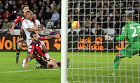 Andre Ayew of Swansea (in white) fails to score with a header during the Barclays Premier League match between Swansea City and Bournemouth at the Liberty Stadium, Swansea on November 21 2015