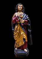Gothic wooden statue of Sant Joan Evangelista (John the Evangelist) from Gremany, circa 1500, tempera and gold leaf on wood.  National Museum of Catalan Art, Barcelona, Spain, inv no: MNAC  64114. Against a black background.