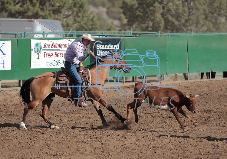 The Rendezvous team competes in the team roping event at the Minden Ranch Rodeo on Saturday, July 21, 2012..Photo by Cathleen Allison