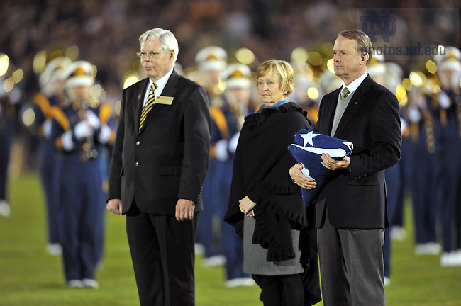 Oct. 22, 2011; Richard Notebaert, chairman of the Board of Trustees, prepares to present the flag before the USC game, 2011...Photo by Matt Cashore/University of Notre Dame