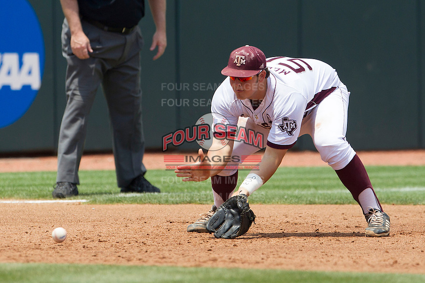Texas A&M Aggies third baseman Hunter Melton (50) fields a grounder against the LSU Tigers in the NCAA Southeastern Conference baseball game on May 11, 2013 at Blue Bell Park in College Station, Texas. LSU defeated Texas A&M 2-1 in extra innings to capture the SEC West Championship. (Andrew Woolley/Four Seam Images).
