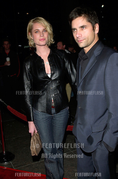 Actor JOHN STAMOS & model wife REBECCA ROMIJN STAMOS at the Los Angeles premiere of Snatch..18JAN2001.  © Paul Smith/Featureflash