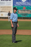 Umpire Stu Bertrand handles the calls on the bases during the Pioneer League game between the Ogden Raptors and the Grand Junction Rockies at Lindquist Field on July 5, 2015 in Ogden, Utah. Ogden defeated Grand Junction 12-2.  (Stephen Smith/Four Seam Images)