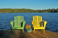 Muskoka chairs  on dock at Star Lake<br /> Whiteshell Provincial PArk<br /> Manitoba<br /> Canada
