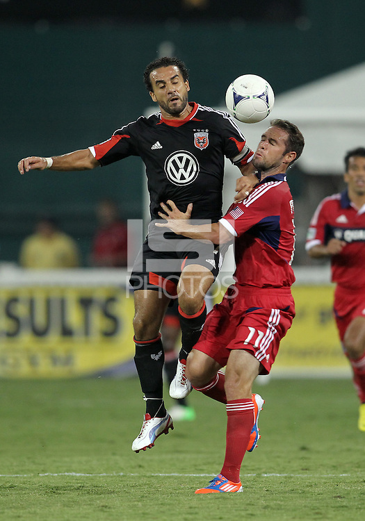 WASHINGTON, DC. - AUGUST 22, 2012:  Dwayne DeRosario (7) of DC United clashes with  Daniel Paladini (11) of the Chicago Fire during an MLS match at RFK Stadium, in Washington DC,  on August 22. United won 4-2.