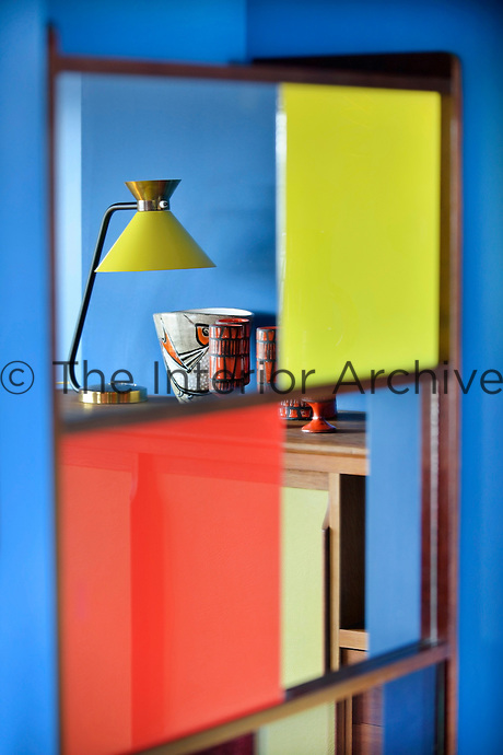 A 1950s lamp is a focus of this colourful retro storage unit