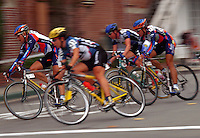 Blurred motion image of a pack of cyclists in competition.