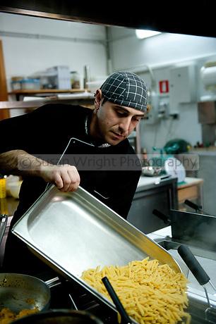 Chef Emiliano Rocchi prepares food with all organic produce from 'Libera Terra' Cooperatives, at Agriturismo 'Portella della Ginestra', near Palermo, Sicily, Italy