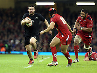 Pictured L-R: Dane Coles of New Zealand against Leigh Halfpenny of Wales Saturday 22 November 2014<br />