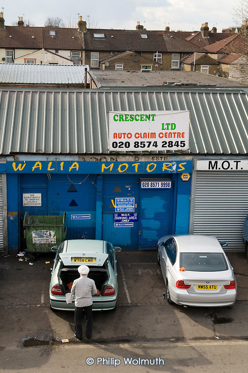 Car repair workshop, Southall, West London.  The area has a large Indian population.