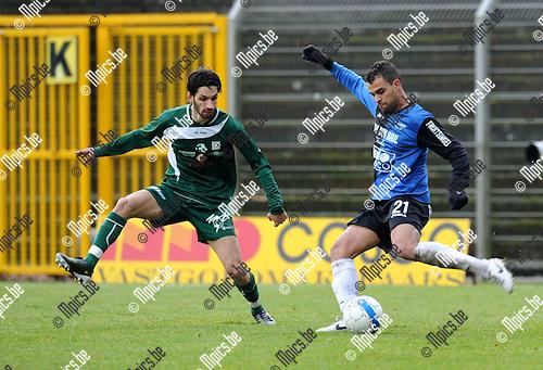 2011-01-23 / Voetbal / seizoen 2010-2011 / Rupel-Boom Boussu Dour / Kaminiaris probeert de voorzet van Daniël Rodgigo de Oliveira (Boom) te onderscheppen..Foto: mpics