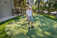 Cam Conner '17 uses the new putting green on the Occidental College campus on March 26, 2015. The outdoor facility may be called: Andrew E. Rubin Practice Facility, including the Pongracz and Wright Families Putting Green & Tiger Golf Hitting Bays.<br /> (Photo by Marc Campos, Occidental College Photographer)