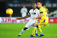 Joel Asoro of Swansea City U21 battles with Michael Kelly of Bristol Rovers during the Checkatrade Trophy match between Swansea City U21 and Bristol Rovers at the Liberty Stadium in Swansea, Wales, UK. Wednesday 05 December 2018