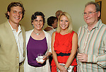 From left: Adam Faust, Maxine Lennon, Piper Faust and Matthew Lennon at a private reception for artist Dennis Oppehheim at the Devin Borden Hiram Butler Gallery Friday July 30,2010.(Dave Rossman/For the Chronicle)