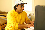 Mature man working on computer, smiling