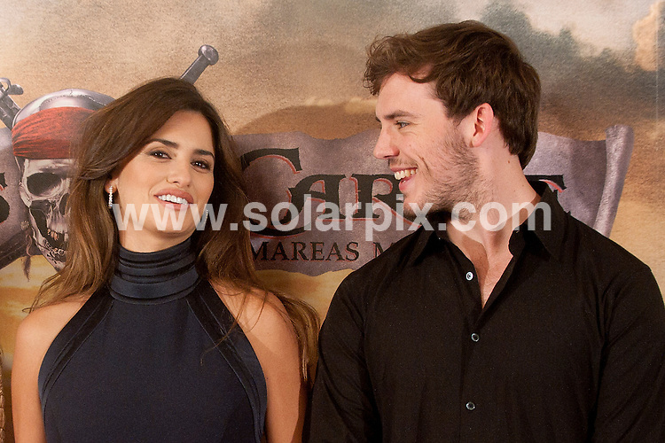 "**ALL ROUND PICTURES FROM SOLARPIX.COM**                                             **WORLDWIDE SYNDICATION RIGHTS EXCEPT SPAIN - NO SYNDICATION IN SPAIN**                                                                                  Photocall for the Spanish premiere of the new movie, ""Pirates of the Caribbean: On Stranger Tides"" in Madrid today.                                                                          .This pic:   Penelope Cruz and Sam Claflin                                                                                          JOB REF:     13369   DMS       DATE:  18.05.11                                                          **MUST CREDIT SOLARPIX.COM OR DOUBLE FEE WILL BE CHARGED**                                                                      **MUST AGREE FEE BEFORE ONLINE USAGE**                               **CALL US ON: +34 952 811 768 or LOW RATE FROM UK 0844 617 7637**"