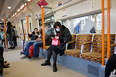 Passenger wearing a face mask on  a London Overground train ten days before the start of the Covid-19 lockdown.