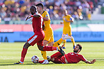Tom Rogic of Australia (C) is challenged by Abdallatif Albahdari (L) and Shadi Shaban of Palestine (R) during the AFC Asian Cup UAE 2019 Group B match between Palestine (PLE) and Australia (AUS) at Rashid Stadium on 11 January 2019 in Dubai, United Arab Emirates. Photo by Marcio Rodrigo Machado / Power Sport Images