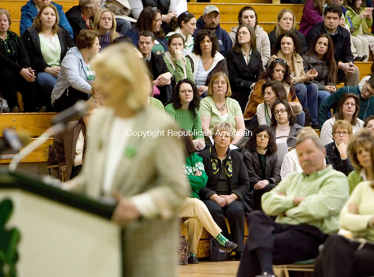 WATERBURY, CT- 17 MARCH 2008- 031708JT09-<br /> Attendants of Monday's Board of Education meeting listen as Mary Kelly speaks in defense of Bucks Hill Principal Ann Begley at Wilby High School.<br /> Josalee Thrift / Republican-American