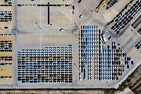 Aerial view of the Ford Motor Company automotive company in the Hermosillo industrial park, Sonora Mexico. Hundreds of new cars ready and arranged in order in the yard to be transported in train cars to the Automotive Industry market in the USA. Hermosillo Stamping and Assembly is an automobile assembly plant of the Ford brand. The plant currently assembles the Ford Fusion and Lincoln MKZ, Lincoln models for the North American market. Auto business Ford is an American multinational automaker. Photo: (NortePhoto / LuisGutierrez) ...<br /> <br /> Vista aérea de empresa automotriz Ford Motor Company .