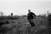 colombia1070 ? Government troops chase after FARC guerrillas. Near Puerto Rico march 2002<br />