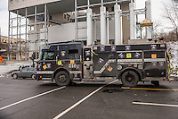 A firetruck painted in black is pictured in Montreal Wednesday November 19, 2014. Montreal firefighters painted trucks black in protest against Bill 3 on municipal pension reform plan.