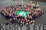 Pupils of Listellick Primary School celebrate the raising of the Green Flag presented to them by An Taisce