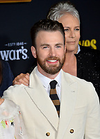 "LOS ANGELES, USA. November 15, 2019: Chris Evans & Jamie Lee Curtis at the premiere of ""Knives Out"" at the Regency Village Theatre.<br /> Picture: Paul Smith/Featureflash"