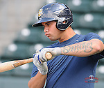 Photo of of the Charleston RiverDogs, a New York Yankees affiliate, in a game against the Greenville Drive on May 31, 2012, at Fluor Field at the West End in Greenville, South Carolina. Charleston won, 13-2. (Tom Priddy/Four Seam Images)