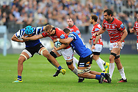 Ed Slater of Gloucester Rugby is tackled by Zach Mercer and Taulupe Faletau of Bath Rugby during the Gallagher Premiership Rugby match between Bath Rugby and Gloucester Rugby at The Recreation Ground on Saturday 8th September 2018 (Photo by Rob Munro/Stewart Communications)