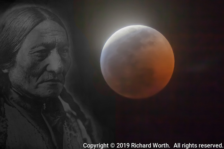 Composite image of an image of Sioux Chief Sitting Bull against the 2019 Full Wolf Moon Lunar Eclipse.