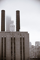 The Sears Tower Captured between the smokestacks of an industrial building.