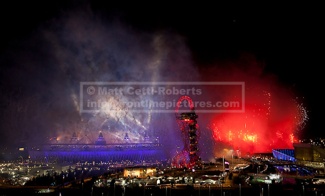 28/07/2012. LONDON, UK. Fireworks are seen over the Olympic Stadium during the opening ceremony of the 2012 Summer Olympics in London today (28/07/12). Constituting the third time the Olympic Games have been held in Great Britain, the 2012 Olympic Games, also known as the Games of the XXX Olympiad opened this evening with a show, put together by 'Slum Dog Millionaire' director Danny Boyle, entitled 'The Isles of Wonder. Photo credit: Matt Cetti-Roberts