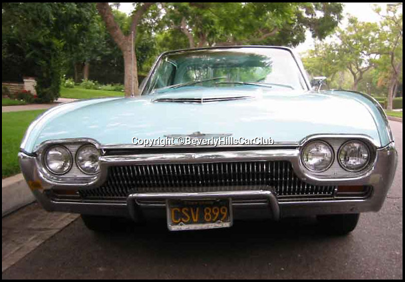 BNPS.co.uk (01202 558833)<br /> Pic: BeverlyHillsCarClub/BNPS<br /> <br /> ***Please Use Full Byline***<br /> <br /> The front of the car. <br /> <br /> A classic Ford Thunderbird car owned by late Clash frontman Joe Strummer has emerged for sale for a mystery sum.<br /> <br /> The rock legend bought the plush motor in 1987, splashing out just 4,200 dollars for it when he moved to the USA in the wake of the band's break-up.<br /> <br /> A huge fan of American cars, Strummer - the genius behind The Clash's biggest hits such as Rock the Casbah, London Calling and Should I Stay of Should I Go - drove the 1963 Thunderbird right up until his untimely death in 2002.<br /> <br /> Following Strummer's sudden death aged 50 from undiagnosed heart problems the car was passed to his publicist.<br /> <br /> The car, which has done 420 miles on its current engine, is now being sold on eBay by the California car dealers Beverly Hills Car Club.