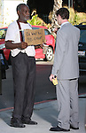 .5-3-09 Exclusive.Danny Glover dressed up like a bum holding a sign up asking for money. .Drinking coffee and eating while reading his lines for a scene for his new movie Death at a Funeral in Los Angeles ca ..AbilityFilms@yahoo.com.805-427-3519.www.AbilityFilms.com.