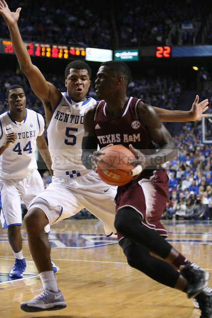 Kentucky Wildcats guard Andrew Harrison (5) defends Texas A&M guard Shawn Smith (2) on drive during the first half of the UK Men's basketball game vs. Texas A&M at Rupp Arena in Lexington, Ky., on Tuesday January 21, 2014. UK defeated Texas A&M 68-51 Photo by Joel Repoley | Staff