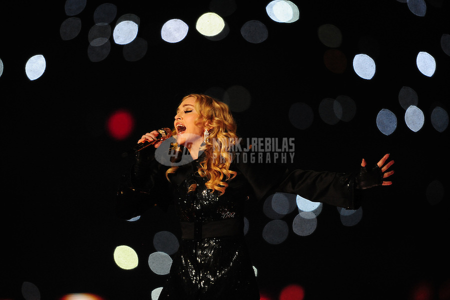 Feb 5, 2012; Indianapolis, IN, USA; Recording artist Madonna performs during the halftime show for Super Bowl XLVI between the New York Giants and New England Patriots at Lucas Oil Stadium.  Mandatory Credit: Mark J. Rebilas-