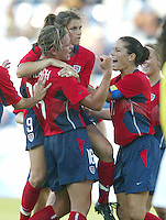 14 August 2004:   Mia Hamm celebrates with Abby Wambach and Julie Foudy after Hamm scored a penalty kick goal at Kaftanzoglio Stadium in Thessaloniki, Greece.  USA defeated Brazil at 2-0. Credit: Michael Pimentel / ISI