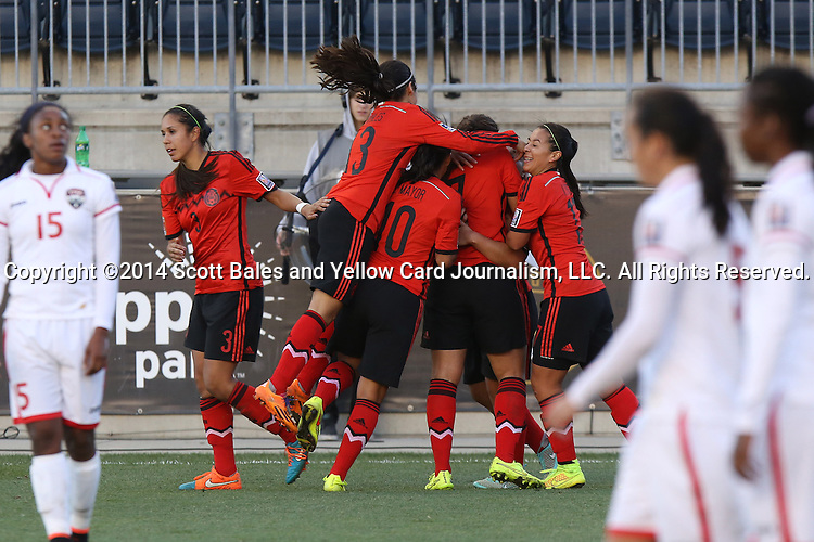 26 October 2014: Veronica Charlyn Corral (MEX) (9) is mobbed by teammates after scoring the go ahead goal in overtime. The Trinidad & Tobago Women's National Team played the Mexico Women's National Team at PPL Park in Chester, Pennsylvania in the 2014 CONCACAF Women's Championship Third Place game. Mexico won the game 4-2 after extra time. With the win, Mexico qualified for next year's Women's World Cup in Canada and Trinidad & Tobago face playoff for spot against Ecuador.