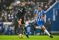 Eden Hazard of Chelsea (10) Dribbles with the ball past Dale Stephens of Brighton & Hove Albion (6)   during the Premier League match between Brighton and Hove Albion and Chelsea at the American Express Community Stadium, Brighton and Hove, England on 20 January 2018. Photo by Edward Thomas / PRiME Media Images.