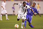 11 March 2008: Maurice Edu (USA) (6) dribbles past Yordany Alvarez (CUB) (10). The United States U-23 Men's National Team tied the Cuba U-23 Men's National Team 1-1 at Raymond James Stadium in Tampa, FL in a Group A game during the 2008 CONCACAF's Men's Olympic Qualifying Tournament.